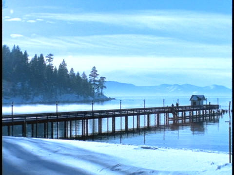 Mist rises from Lake Tahoe Stock Video Footage