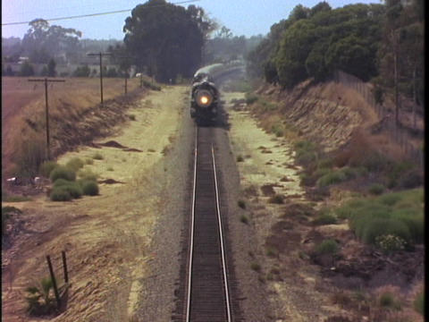 A steam train passes through a countryside Stock Video Footage