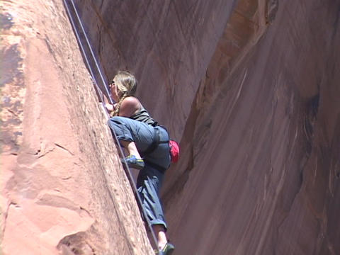 A rock climber scales a wall Live Action