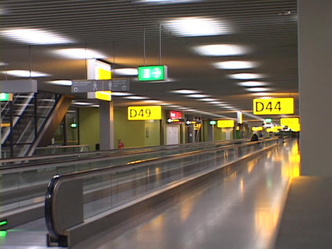 Signs glow above an empty airport terminal Stock Video Footage