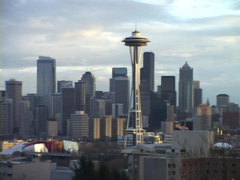 The Space Needle rises above the Seattle city skyline in... Stock Video Footage