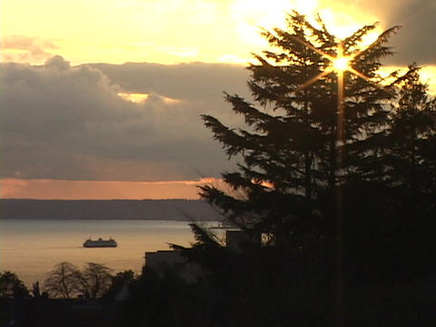 A ferry boat cruises on the calm waters of Puget Sound in Seattle, Washington Footage