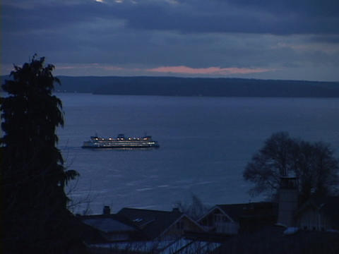 A ferryboat leaves the Seattle harbor Stock Video Footage