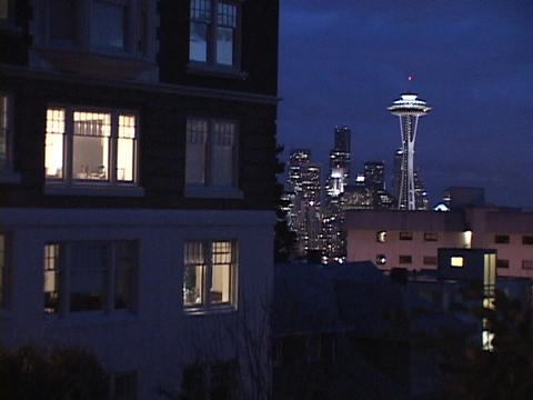 The Space Needle towers above apartment buildings Stock Video Footage