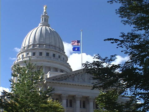 The United States Flag flies over the Capitol building in Madison, Wisconsin Live Action