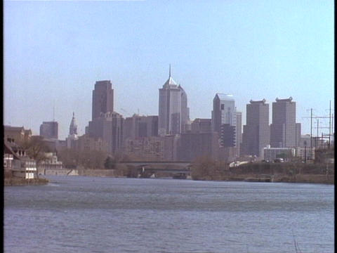 The Philadelphia skyline stands in the distance on a hazy day Footage