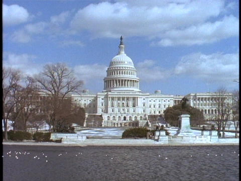 The United States Capitol building rests along the Potomac River in Washington, DC Footage