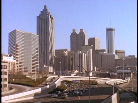 Skyscrapers tower over an Atlanta freeway Stock Video Footage