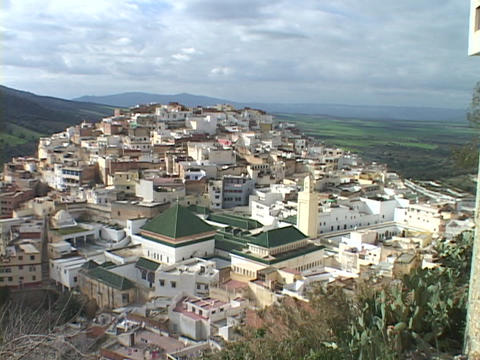 The ancient village of Moulay Idriss nestles among the... Stock Video Footage