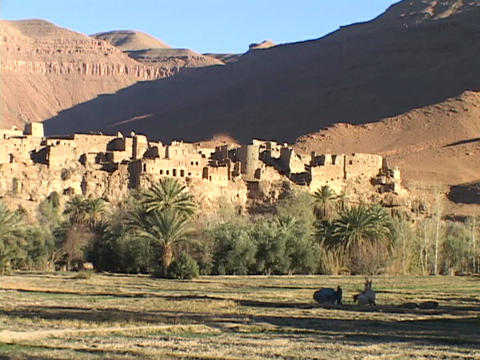 An ancient fortress resides in the middle of a Moroccan desert Footage