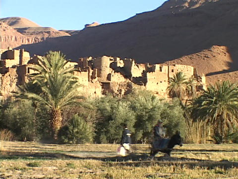 Moroccan men meet on the road in front of a deserted... Stock Video Footage