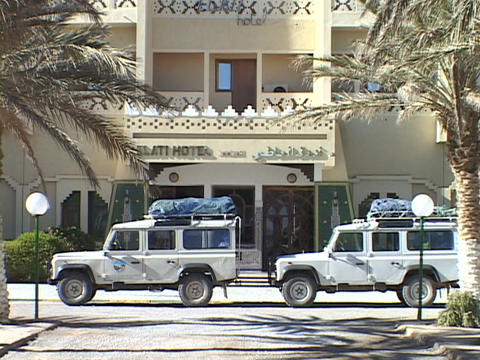Land Rovers sit parked in front of a hotel prepared for a... Stock Video Footage