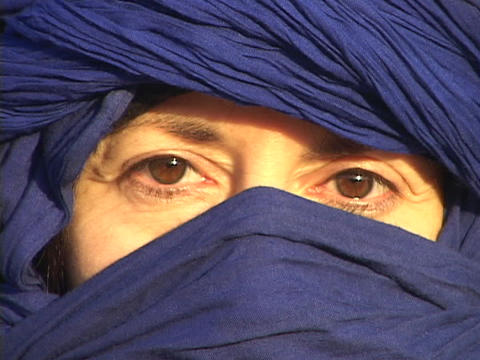 The eyes of an Arab woman show through her blue abaya Stock Video Footage
