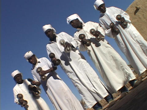 Sudanese men perform a traditional dance of welcome Stock Video Footage