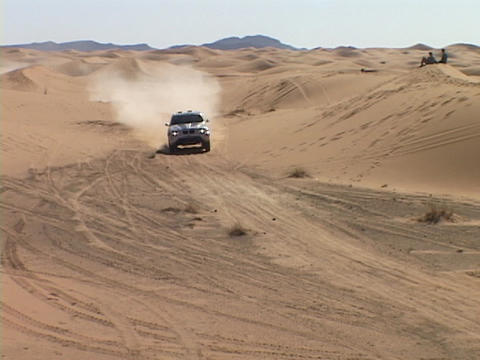 A rally car races across a desert course Stock Video Footage