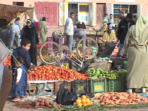 A crowd of people shop at an Moroccan outdoor market Stock Video Footage