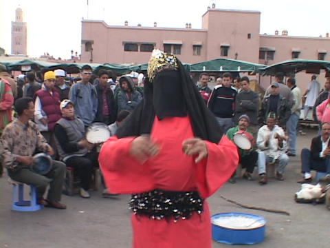 A person in traditional Islamic clothing dances for a crowd Stock Video Footage