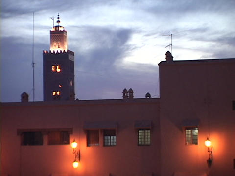 Guards stand watch on top of a building Stock Video Footage
