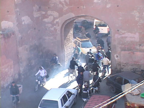 way traffic fights to go through a small tunnel on a busy street in Marrakesh Morocco Footage