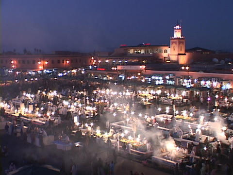 Smoke rises from food stalls at a night-time market in... Stock Video Footage
