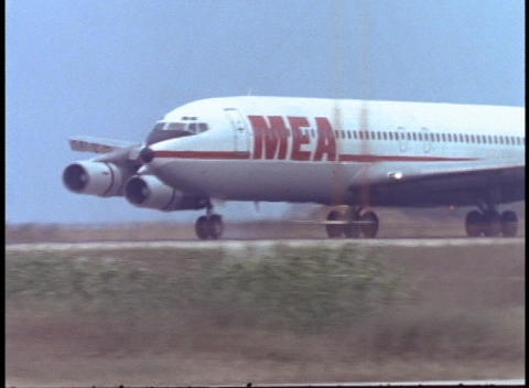 A Middle East Airlines Jet Descends And Lands On The Runway. stock footage