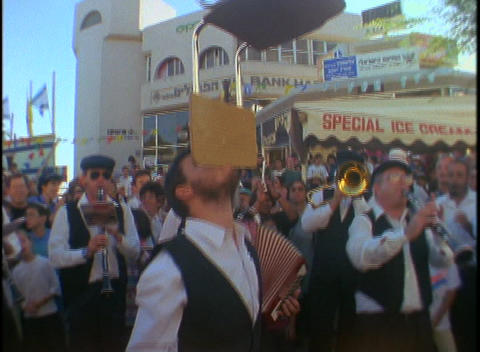 A man balances chairs on his chin at a Jewish festival in... Stock Video Footage
