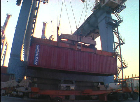 A crane lifts a cargo container Stock Video Footage