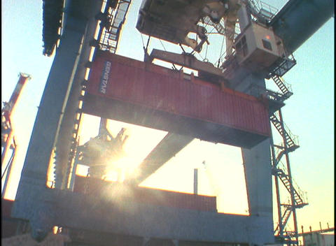 A crane lifts a cargo container Footage