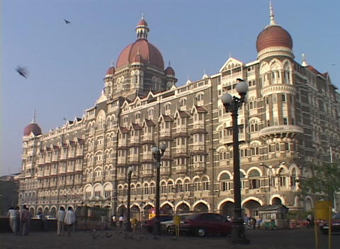 The exterior of the Taj Mahal Hotel in Bombay, India with birds flying Footage