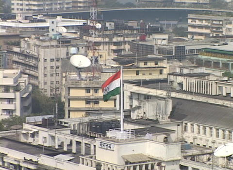 A high angle view of Bombay India with the Indian flag in the foreground Footage