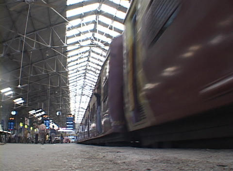 Trains leave the Mumbai Victoria train station Footage