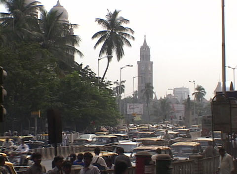 Crowds and traffic outside Mumbai railway station Stock Video Footage