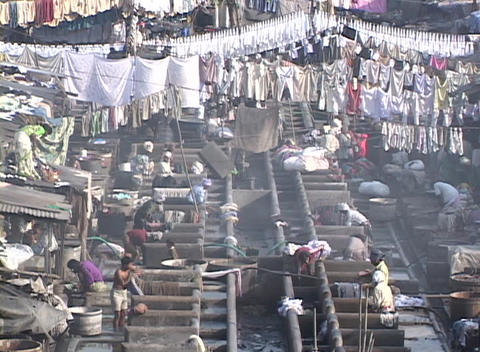 People wash cloths at the dhobi gnats, open air... Stock Video Footage