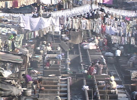 People wash cloths at the dhobi gnats, open air laundries, in Bombay India Footage