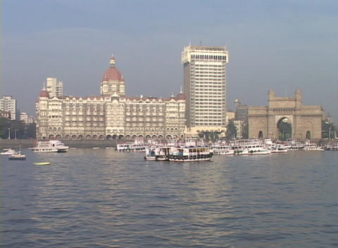 The exterior of the Taj Mahal Hotel in Bombay, India as seen from the POV of the harbor Footage