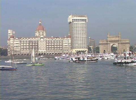 Boats enter and exit the harbor with the Taj Mahal Hotel... Stock Video Footage