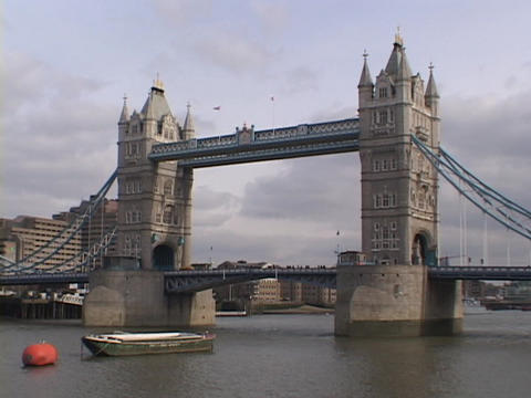 The majestic London and Westminster Bridges span the River Thames in London, England Footage
