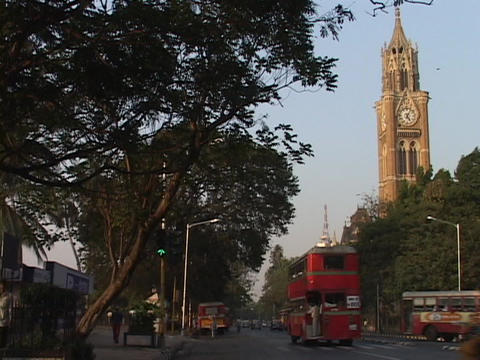 A double-decker bus drives on a street in Bombay Footage