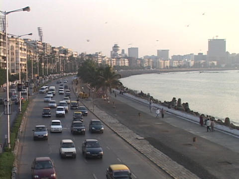 Traffic travels on Marine Drive in Mumbai, India Stock Video Footage