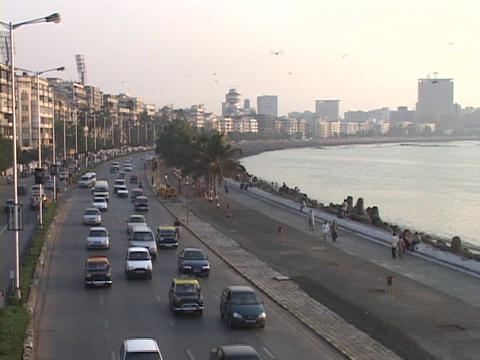 Traffic travels on Marine Drive in Mumbai, India Live Action
