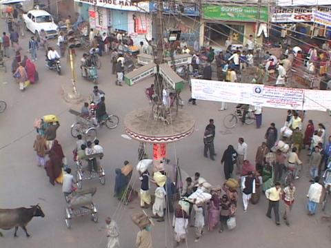 Pedestrians crowd a city street in Varanasi, India Stock Video Footage