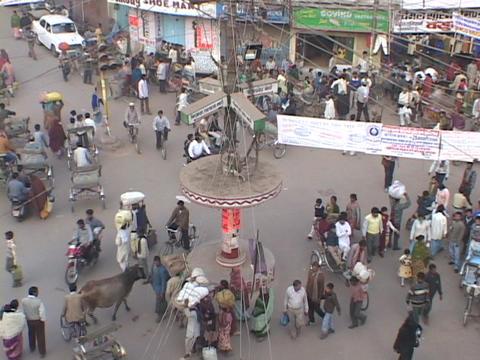 Pedestrians crowd a city street in Varanasi, India Footage