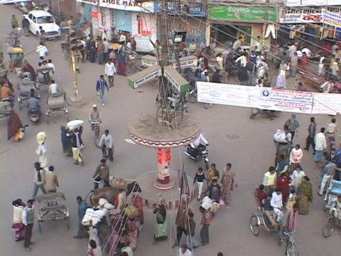 Pedestrians crowd a city street in Varanasi, India Stock Video Footage