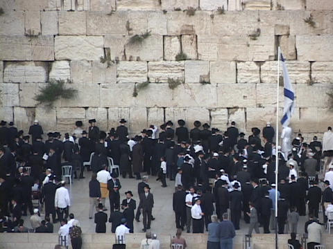 Orthodox Jews pray at the Wailing Wall in the Old City,... Stock Video Footage