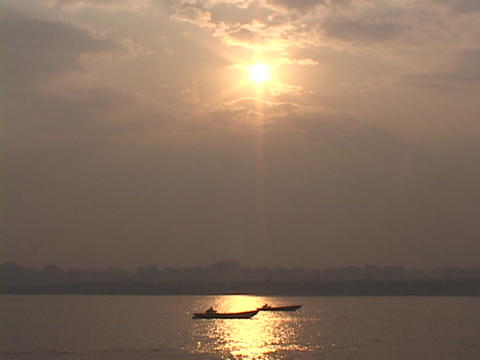 boats languidly float on the Ganges River at sunrise Stock Video Footage