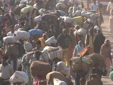 Indians fill the roadways in India leaving little room... Stock Video Footage