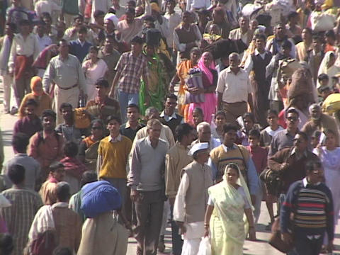 Huge crowds of people walk on the road in India Stock Video Footage
