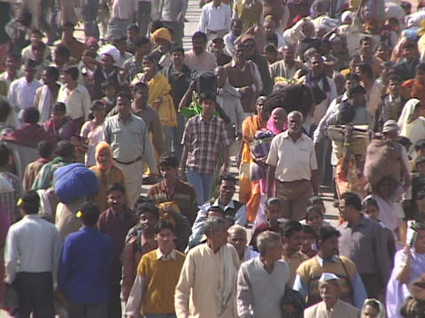 Huge crowds of people walk on the road in India Footage