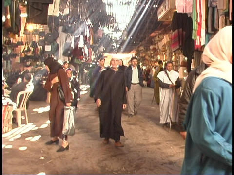 Pedestrians walk through a covered bazaar in Marrakesh, Morocco Footage