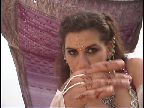 A belly dancer wears traditional clothing and performs a... Stock Video Footage